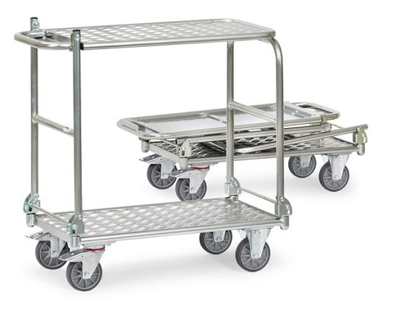 Der klappbare Tisch hat zwei Einsatzmöglichkeiten - er dient als Transportwagen und als Arbeitstisch.